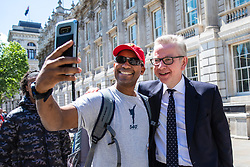 © Licensed to London News Pictures. 21/05/2019. London, UK. Secretary of State for Environment, Food and Rural Affairs Michael Gove (R) poses for a selfie with a member of the public as he leaves after the Cabinet meeting. Prime Minister Theresa May is expected to make a statement to Paliament outlining changes to the Withdrawal Agreement Bill before it is brought back before Parliament. Photo credit: Rob Pinney/LNP