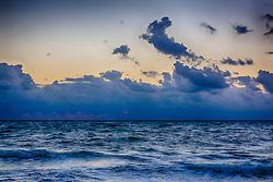 beautiful sunrise through clouds over the ocean in Florida