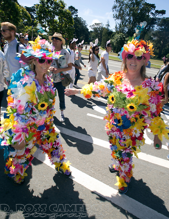 """Two women who identified themselves as """"Flower Floozies"""" walk through Golden Gate Park during the 103rd running of the Bay to Breakers 12K race, Sunday, May 18, 2014 in San Francisco. (Photo by D. Ross Cameron)"""