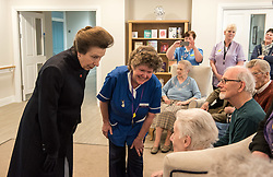 April 13, 2018 - Keynsham, Bath and North East Somerset, UK - Keynsham, Bath & North East Somerset, UK. Visit of Her Royal Highness, The Princess Royal, PRINCESS ANNE, to switch on a giant sun art installation marking the Grand Opening of the development of the Chocolate Quarter in Keynsham on the site of the former Frys and Cadburys Chocolate factory which closed in 2011. The art installation is a giant artificial sun that will glow between the iconic red-brick buildings, radiating warmth, light and sound for a sensory exploration that the public are invited to discover and walk beneath. The installation is seven metres high and six metres wide and symbolises a new dawn for the historic building which is now home to a vast intergenerational living complex of retirement homes, pizzeria, restaurant, spa and cinema. The Chocolate Quarter is home to 136 retirement apartments and Charterhouse, a 93-bed care home. (Credit Image: © Simon Chapman/London News Pictures via ZUMA Wire)