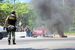 April 28, 2017 - Pernambuco, Brazil - General strike against Labor and Social Security reforms began with deserted avenues and closed stores in the center of Recife. At 10 am a group of health workers protested in front of the Council of Aldermen and blocked the intersection with tires. The protest ended at noon without incident. (Credit Image: © Veetmano Prem/Fotoarena via ZUMA Press)