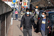 As the third national coronavirus lockdown in Birmingham continues, a few people still come to the city centre wearing face masks to visit the few essential shops that remain open or simply to hang out as the country awaits the easing of lockdown restrictions on 24th March 2021 in Birmingham, United Kingdom. Following the recent surge in cases including the new variant of Covid-19, this nationwide lockdown, which is an effective Tier Five, came into operation yesterday, with all citizens to follow the message to stay at home, protect the NHS and save lives.