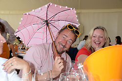 JANE SLADE and JON FURNISS at the Veuve Clicquot Gold Cup, Cowdray Park, Midhurst, West Sussex on 21st July 2013.