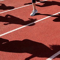 The San Lorenzo Valley High School boys and girls cross country teams cast dramatic shadows as the warm up at the beginning of practice on the SLV track in Felton, California.<br /> Photo by Shmuel Thaler <br /> shmuel_thaler@yahoo.com www.shmuelthaler.com
