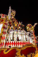 "Performers on floats in the Carnaval parade of Academicos do Salgueiro samba school in the Sambadrome, Rio de Janeiro, Brazil.               The theme of their parade is ""The Black King of the Riding Arena"". It is a tribute to Benjamin de Oliveira, the first black clown in Brazil."