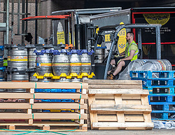 "© Licensed to London News Pictures. 03/07/2020. London, UK. Roll out the Barrels. Workers at Fullers Brewery on the Great West Road, Chiswick load up beer barrels for ""Super Saturday"" as cafes, restaurants, pubs and hairdressers, prepare for the big opening tomorrow after Prime Minister Boris Johnson gave the go ahead in his statement to the Nation last week. Photo credit: Alex Lentati/LNP"
