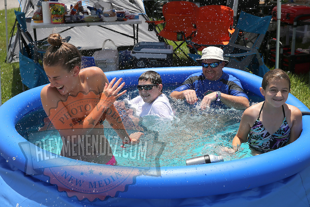 The Lamham family from Ocala, Florida plays in the pool prior to the 57th Annual NASCAR Coke Zero 400 stock car race at Daytona International Speedway on Sunday, July 5, 2015 in Daytona Beach, Florida.  (AP Photo/Alex Menendez)