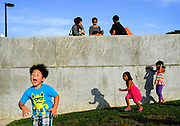 Four-year old Owen Kim (left) of East Brunswick, along with other children of all ages, expend some energy prior to the arrival of children's performer Mark Rust during a free concert held at the East Brunswick Community Arts Center in East Brunswick on July 25.