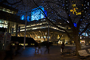 People walking along the riverside walkway at the National Theatre as dusk turns to evening on the Southbank, London, United Kingdom. The South Bank is a significant arts and entertainment district, and home to an endless list of activities for Londoners, visitors and tourists alike. (photo by Mike Kemp/In Pictures via Getty Images)