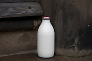 Milk bottle on a doorstep in Lichfield, England, United Kingdom.