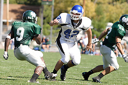 15 September 2007:  Marcus Dunlop cuts hard left to avoid Erik Prosser. The Titans stood toe to toe with the 25th ranked Lions through the first half but ended the game on the losing end of a 25-15 score at Wilder Field on the campus of Illinois Wesleyan University in Bloomington Illinois.