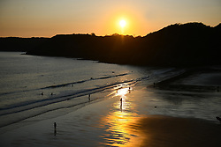 © Licensed to London News Pictures. 13/09/2020. Swansea, UK. The sunsets at Caswell Bay, Mumbles, on a beautiful evening in south Wales. The UK enjoyed a fine weekend of warm and sunny weather. Photo credit: Robert Melen/LNP