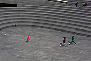 Young boys play football during the UKs Conoriavirus pandemic lockdown, on 7th June 2020, in London, England.