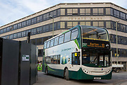 Electric hybrid green number 8 bus drives past the County Hall in Oxford, England, United Kingdom.  Stagecoach hybrid buses are more environmentally greener than traditional buses using 30% fuel and third less CO2 emissions, the buses are also much quieter.