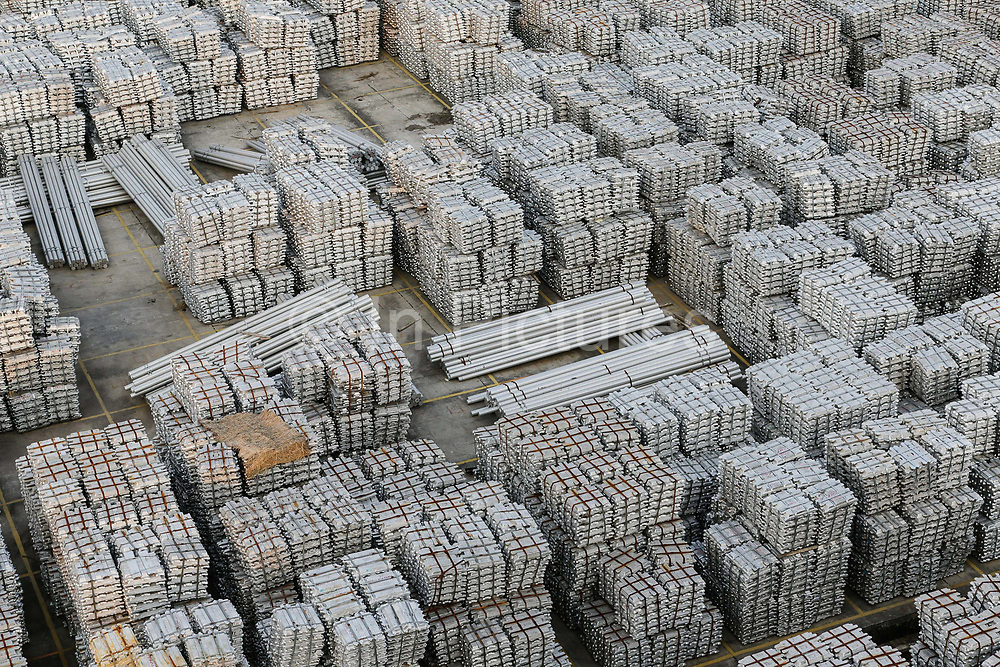 A view of a stockyard filled with aluminum ingots in Wuxi, Jiangsu Province, China on 26 September 2013. China is faced with an over capacity in its production of raw material such as steel and aluminum, as a result of its massive economic stimulus package in 2009, many local governments encouraged the expansion of heavy industries which has created a huge glut in raw material as China's economy begins to slow down.