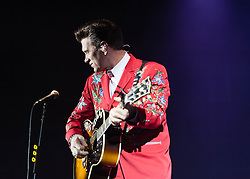 "© Licensed to London News Pictures. 09/10/2012. London, UK.   Chris Isaak performing live at Hammersmith Apollo. Christopher Joseph ""Chris"" Isaak (born June 26, 1956 is an American rock musician and occasional actor.  He is touring to support his latest album ""Beyond the Sun"", which consists of covers of songs by artists who recorded at the legendary Sun Studios in Memphis, Tenessee.   Photo credit : Richard Isaac/LNP"