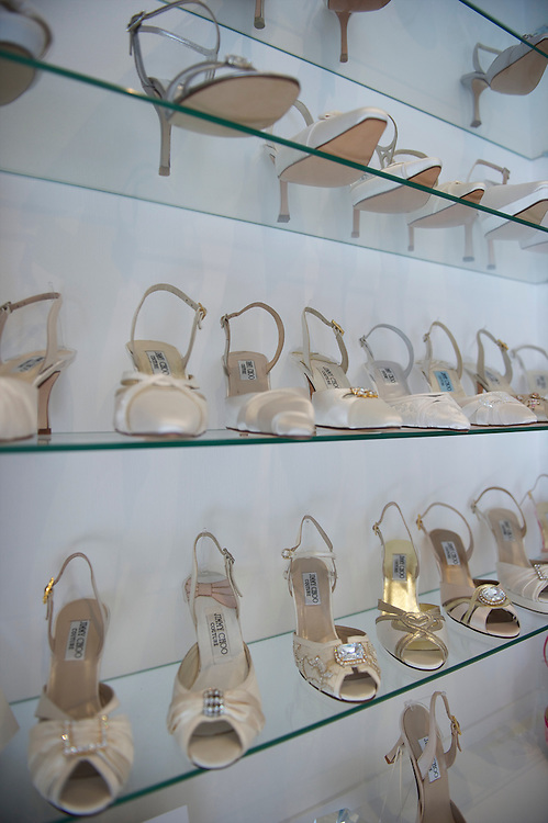 A selection of wedding themed high heeled shoes are displayed in fashion designer Jimmy Choo's showroom on Cannaught Street, London, March 22, 2010.