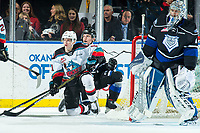 KELOWNA, BC - JANUARY 3:  Pavel Novak #11 of the Kelowna Rockets gets up off the ice after a check by Jacob Herauf #2 of the Victoria Royals at Prospera Place on January 3, 2020 in Kelowna, Canada. (Photo by Marissa Baecker/Shoot the Breeze)