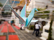 31 DECEMBER 2013 - BANGKOK, THAILAND: An origami dove hangs in Wat Pathum Wanaram on New Year's Eve. Hundreds of thousands of people pack into the Ratchaprasong Intersection in Bangkok for the city's annual New Year's Eve countdown. Many Thais go the Erawan Shrine and Wat Pathum Wanaram near the intersection to pray and make merit.     PHOTO BY JACK KURTZ