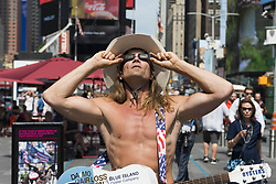 August 21, 2017 - New York, NY, U.S - The NAKED COWBOY watching for the solar eclipse as seen in Times Square in New York City, NY on August 21, 2017. (Credit Image: © Michael Brochstein via ZUMA Wire)