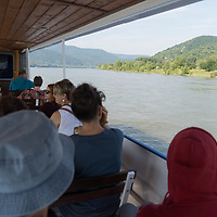 Passengers enjoy the view of the bend of River Danube from a boat after the ease of the COVID-19 restrictions near Nagymaros, Hungary on June 29, 2020. ATTILA VOLGYI