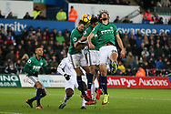 Ahmed Hegazi (26), Cladio Yacob © and Jonny Evans of West Bromwich Albion jump to head clear from a corner. Premier league match, Swansea city v West Bromwich Albion at the Liberty Stadium in Swansea, South Wales on Saturday 9th December 2017.<br /> pic by  Andrew Orchard, Andrew Orchard sports photography.