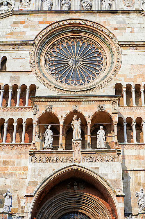 Romanesque facade of the Romanesque Cathedral of Cremona, begun 1107, with later Gothic, Renaissance & Baroque elements, Cremona, Lombardy, northern Italy .<br /> <br /> Visit our ITALY HISTORIC PLACES PHOTO COLLECTION for more   photos of Italy to download or buy as prints https://funkystock.photoshelter.com/gallery-collection/2b-Pictures-Images-of-Italy-Photos-of-Italian-Historic-Landmark-Sites/C0000qxA2zGFjd_k<br /> <br /> <br /> Visit our MEDIEVAL ART PHOTO COLLECTIONS for more   photos  to download or buy as prints https://funkystock.photoshelter.com/gallery-collection/Medieval-Middle-Ages-Art-Artefacts-Antiquities-Pictures-Images-of/C0000YpKXiAHnG2k
