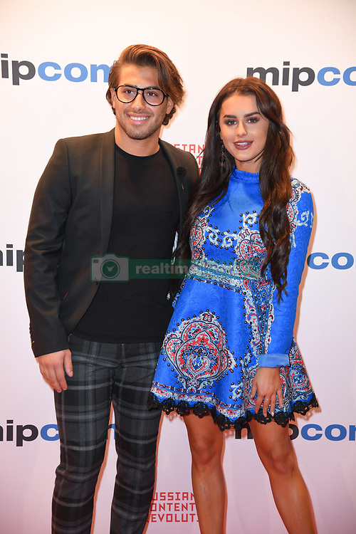 Kem Cetinay, Amber Davies poses as arriving for the opening ceremony of the MIPCOM in Cannes - Marche international des contenus audiovisuels du 16-19 Octobre 2017, Palais des Festivals, Cannes, France.<br />Exhibition MIPCOM (International Market of Communications Programmes) at Palais des Festivals et des Congres, Cannes (Photo by Lionel Urman/Sipa USA)