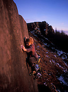 Hazel Findlay bouldering on Little Skyline slab. The Roaches, Staffordshire