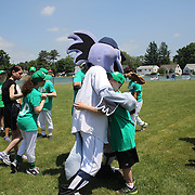 Players with BB the Bridgewater Bluefish mascot during the Norwalk Little League baseball 'Champions' team V Greenwich in the Challenger Division  Recognition Day competition. The day acknowledged the many talents of the great players on the Challenger Division teams. The division has weekly games and practices for kids with special needs. Challenger division are held throughout the country.  Broad River Fields, Norwalk, Connecticut. USA. 2nd June 2013. Photo Tim Clayton