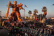"""The """"Pa-drone"""", representative and ironic allegorical chariot about the overwhelming power of the president of the United States Donald Trump. Fabrizio Galli has signed this work for the winter of 2019. The Viareggio Carnival is the virtual place where specialized craftsmanship and technology come together to create works of the highest quality and spectacle. The Viareggio Carnival has above all the uniqueness of being a full-time job and not a hobby for a few dozen artisans belonging not only to historical carter families but new professionals trained in specific schools or more properly grown in the Carnival factory"""