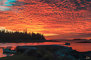 Dramatic sunrise on Penobscot Bay, lobstermen just going out to check their traps. Crisp fall morning in October.
