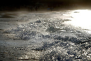 """SHOT 1/18/2007 -Waves crash onto the beach as the sun sets in Sayulita, Mexico. Sayulita is a small fishing village about 25 miles north of downtown Puerto Vallarta in the state of Nayarit, Mexico. Known for its rivermouth surfbreak, roving surfers """"discovered"""" Sayulita in the late 60's with the construction of Mexican Highway 200. Today, Sayulita is a prosperous growing village of approximately 4,000 residents. Hailed as a popular off-the-beaten-path travel destination, Sayulita offers a variety of activities such as horseback riding, hiking, jungle canopy tours, snorkeling and fishing. Still a mecca for beginner surfers of all ages, the quaint town attracts upscale tourists with its numerous art galleries and restaurants as well. Sayulita has a curious eclectic quality, frequented by native Cora and Huichol peoples, travelling craftsmen (and women) as well as by international tourists. Sayulita is the crown jewel in the newly designated """"Riviera Nayarit"""", the coastal corridor from Litibu to San Blas. It's stunning natural beauty and easy access to Puerto Vallarta have made Sayulita real estate some of the most sought after in all of Mexico..(Photo by Marc Piscotty © 2007)"""