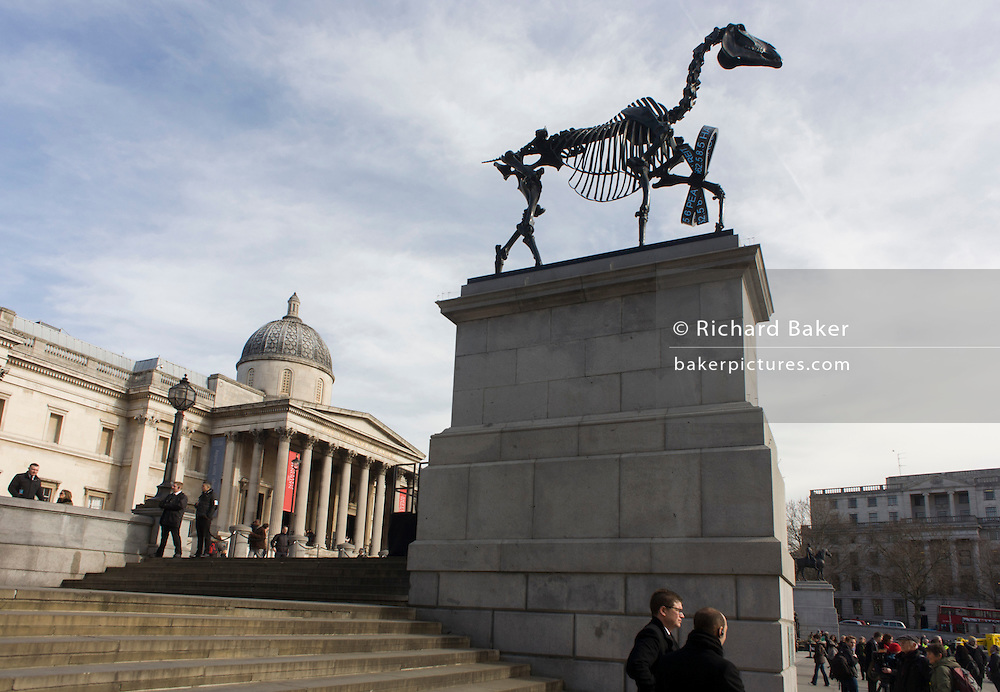 London, 5th March 2015: The sculpture known as Gift Horse, by German artist Hans Haacke, is unveiled in London's Trafalgar Square on the public space called the Fourth Plinth. London mayor Boris Johnson financed the 10th artwork to appear here. The skeletal, riderless horse (derived from The Anatomy of a Horse - George Stubbs, 1766) with a London Stock Exchange tickertape is a comment on power, money and history.
