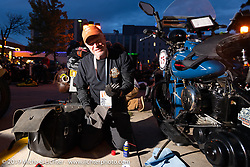 Gary Shorman working on his 1940 Harley-Davidson WL750cc Flathead during the Cross Country Chase motorcycle endurance run from Sault Sainte Marie, MI to Key West, FL (for vintage bikes from 1930-1948). Stage 2 from Ludington, MI to Milwaukee, WI, USA. Saturday, September 7, 2019. Photography ©2019 Michael Lichter.