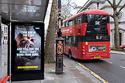 A government NHS (National Heath Service) ad at a Bus stop near the Royal Courts of Justice displays the face of a Covid patient, urging Londoners to stay at home and to socially distance, outside the Royal Courts of Justice, on 3rd February 2021, in London, England.