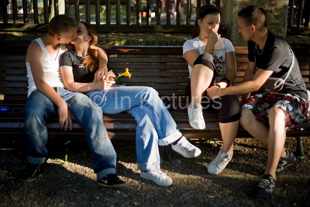 Teenage lovers embrace and kiss on a park bench in Pecs, Hungary.Pecs has been chosen as the 2010 European City of Culture. The city is on the southern slopes of the Mecsek Hills and has a sub-Mediterranean climate. Settled by Romans as Sopianae, it was a significant Christian settlement. Later conquered by the Ottomans, it has important Turkish architecture.