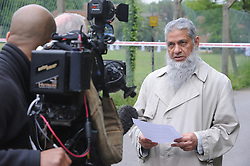 © Licensed to London News Pictures. 09/06/2013, London, UK.  School adviser Saiyed Mahmood speaking outside Darululoom Islamic boarding school in Chislehurst, southeast London where a 'suspicious' fire broke out, Sunday, June 9, 2013. Photo credit : Grant FalveyLNP
