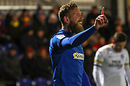 AFC Wimbledon midfielder Scott Wagstaff (7) wagging his finger during the EFL Sky Bet League 1 match between AFC Wimbledon and Peterborough United at the Cherry Red Records Stadium, Kingston, England on 12 March 2019.