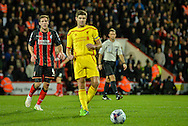 Steven Gerrard and Dan Gosling during the Capital One Cup match between Bournemouth and Liverpool at the Goldsands Stadium, Bournemouth, England on 17 December 2014.