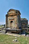 Picture of  A18 of the Tomb North Necropolis. Hierapolis archaeological site near Pamukkale in Turkey.<br /> <br /> Tomb A 18 ( 1st century AD) <br /> <br /> The building, one of the most representative and best conserved of the North Necropolis, has the shape of a small temple, built to a square plan with regular walls. The facade is framed by projecting pilasters; the roofing slabs rest on the, two frontons and the lateral cornices.- Beneath the base is a subterranean chamber partially carved into of the rock. The two chambers have sepulchral beds along the walls. .<br /> <br /> If you prefer to buy from our ALAMY PHOTO LIBRARY  Collection visit : https://www.alamy.com/portfolio/paul-williams-funkystock/pamukkale-hierapolis-turkey.html<br /> <br /> Visit our TURKEY PHOTO COLLECTIONS for more photos to download or buy as wall art prints https://funkystock.photoshelter.com/gallery-collection/3f-Pictures-of-Turkey-Turkey-Photos-Images-Fotos/C0000U.hJWkZxAbg
