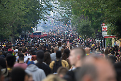 London, August 29th 2016. Tens of thousands of revellers fill Kensington Park Road during day two of Europe's biggest street party, the Notting Hill Carnival.