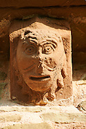 Norman Romanesque exterior corbel no 3 - sculpture of a head, half man half lion. The wide mouth is the same style as theatrical masks. The Norman Romanesque Church of St Mary and St David, Kilpeck Herefordshire, England. Built around 1140 .<br /> <br /> Visit our MEDIEVAL PHOTO COLLECTIONS for more   photos  to download or buy as prints https://funkystock.photoshelter.com/gallery-collection/Medieval-Middle-Ages-Historic-Places-Arcaeological-Sites-Pictures-Images-of/C0000B5ZA54_WD0s