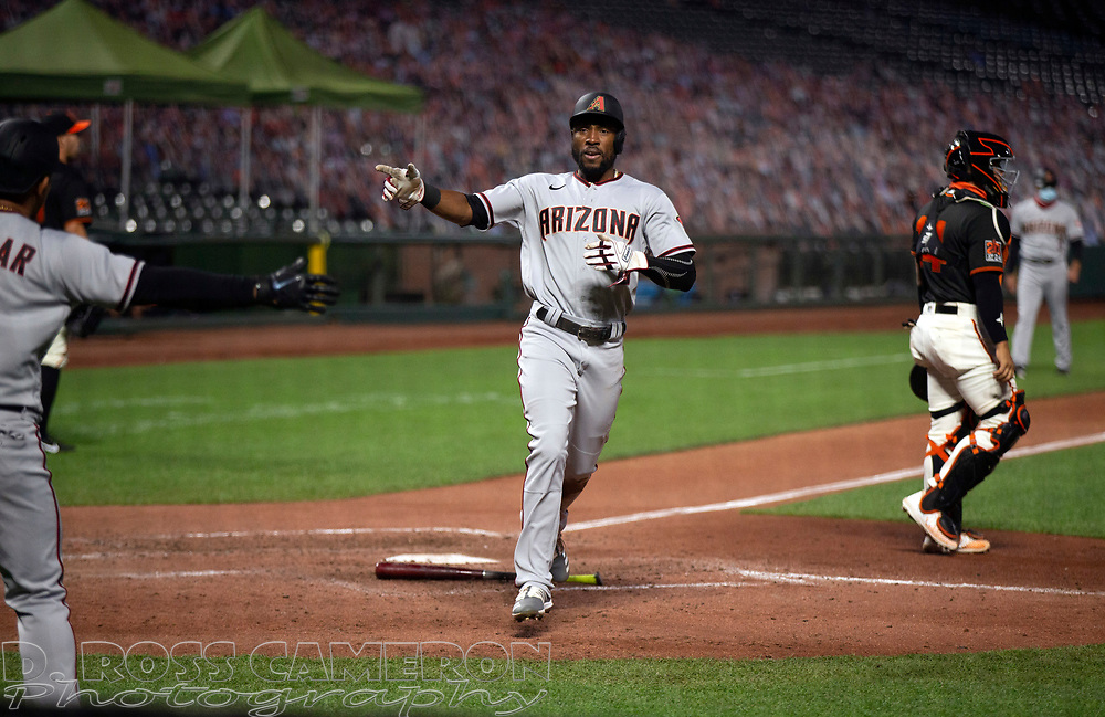 Aug 22, 2020; San Francisco, California, USA; Arizona Diamondbacks Starling Marte scores on a single by David Peralta during the seventh inning of a baseball game against the San Francisco Giants at Oracle Park. Mandatory Credit: D. Ross Cameron-USA TODAY Sports