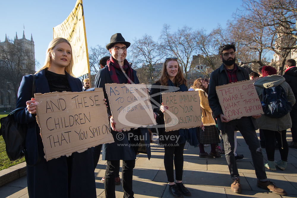 """Westminster, London, January 19th 2016. Students hold an """"emergency protest"""" in Parliament Square and later blocking Westminster Bridge, against the cutting of maintenance grants. """"It took just 18 MPs 90 minutes to scrap maintenance grants for the million poorest students, without a debate in Parliament in a backroom committee"""" PICTURED: Students display their placards to the press. ///FOR LICENCING CONTACT: paul@pauldaveycreative.co.uk TEL:+44 (0) 7966 016 296 or +44 (0) 20 8969 6875. ©2015 Paul R Davey. All rights reserved."""