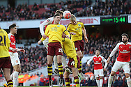 Calum Chambers of Arsenal is challenged by Ben Mee of Burnley and Stephen Ward of Burnley from a corner. The Emirates FA cup, 4th round match, Arsenal v Burnley at the Emirates Stadium in London on Saturday 30th January 2016.<br /> pic by John Patrick Fletcher, Andrew Orchard sports photography.