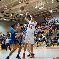 In Gallup, Brad Lynch (34) of Gallup jumps out of bounds and passes to Isaac Bustinza (12) over Bloomfield defenders on Thursday. Gallup won 68-47.