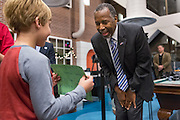 Retired Neurosurgeon and Republican presidential candidate Dr. Ben Carson reacts to a young patients card showing his support during a visit to the MUSC Children's Hospital December 22, 2015 in Charleston, South Carolina. Carson stopped by to listen to Christmas carols and greet the young patients.