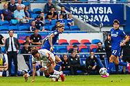 Bournemouth forward Morgan Rogers (27) is tackled by Cardiff City defender Aden Flint  (5) during the EFL Sky Bet Championship match between Cardiff City and Bournemouth at the Cardiff City Stadium, Cardiff, Wales on 18 September 2021.