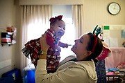 """Seven month-old Beatrice Anne del Rosario, (left) laughs with Resident Nurse Mary Bridget Bowen in General Pediatrics at Rush University Medical Center on Friday December 24, 2010. """"It's amazing to form those relationships because you feel like a part of the family,"""" Bowen said.<br /> <br /> (William DeShazer/ Chicago Tribune) B58936644Z.1<br /> ....OUTSIDE TRIBUNE CO.- NO MAGS,  NO SALES, NO INTERNET, NO TV, NEW YORK TIMES OUT, CHICAGO OUT, NO DIGITAL MANIPULATION..."""